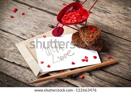 Red Cart with St. Valentine's Day Little Hearts and  Letter Isolated on White Your Own Text