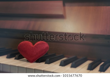 Red cartoon heart put on keyboard's piano, To tell love to learn music or to tell someone love in special day and valentine day. #1015677670