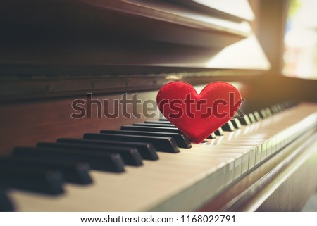 Red cartoon heart put on keyboard's piano, To tell love to learn music or to tell someone love in special day and valentine day. #1168022791