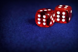Red Casino Dice on blue background