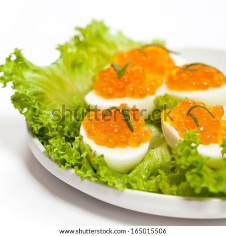 Red caviar canape with quail egg and rosemary stock photo for Quail egg canape