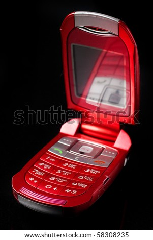 Red cell phone over black