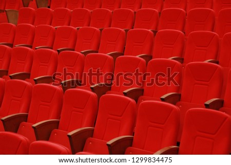 red chair at cinema or theatre saloon #1299834475