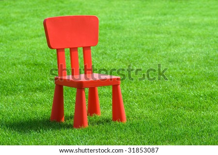 red chair on grass