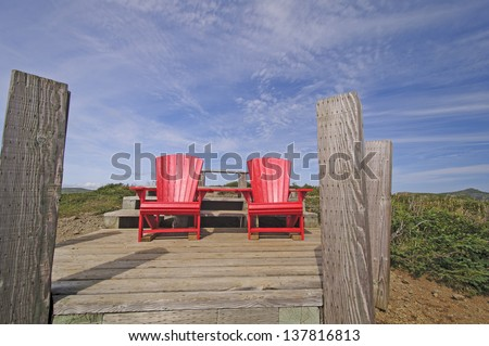 Red Chairs at the top of Signal Hill in Gros Morne National Park