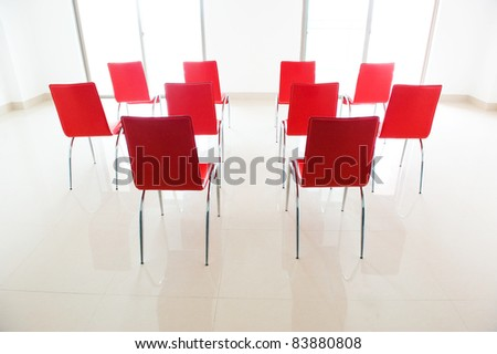 red chairs in ordinary empty waiting room.