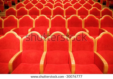Red chairs in some theater