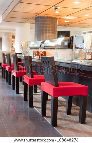 Red chairs near bar in sushi restaurant, indoor
