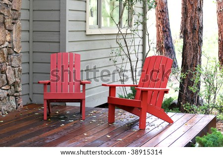 red chairs on front porch in wooded area