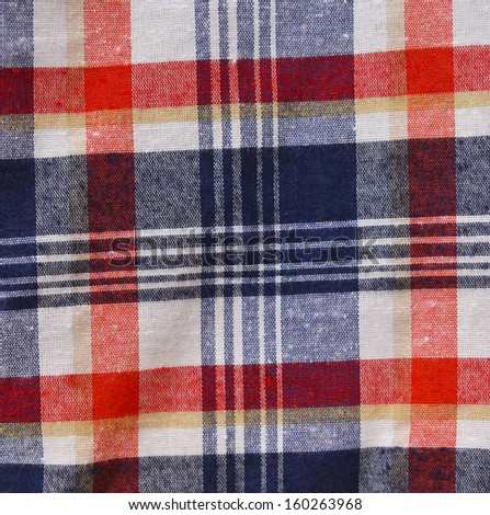 red checked fabric abstract texture.
