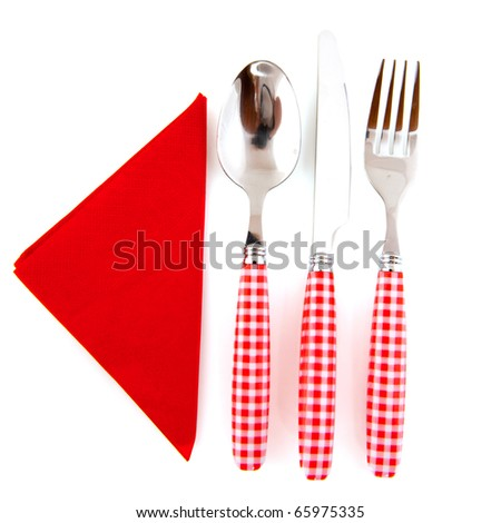 Red checkered cutlery with napkin isolated over white background