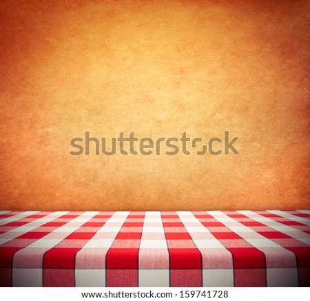 Red Checkered Tablecloth On Textured Wall
