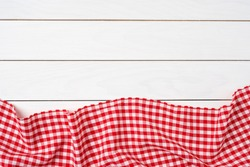 Red checkered tablecloth over white wooden table