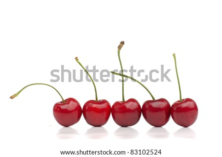 Red cherries in a row isolated on white
