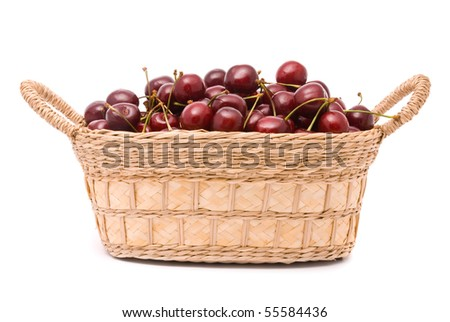 Red cherries in wooden basket isolated on white - stock photo