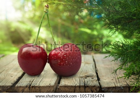 Red cherry on the desk #1057385474