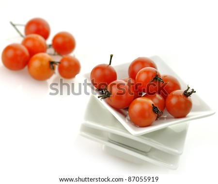 Red Cherry Tomatoes In White Plate - stock photo