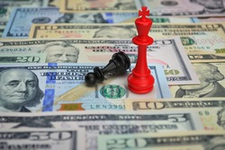 Red chess king wins the game vs black pawn with calculator and pencil on dollar bank note money, Business strategy and success concept, 3d rendering