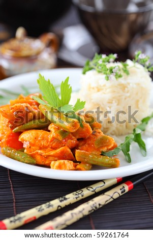Red chicken curry stripes with rice and vegetable