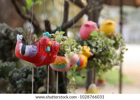Red chicken flowerpot  #1028766031