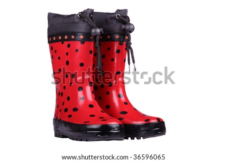 Red children boots on a white background