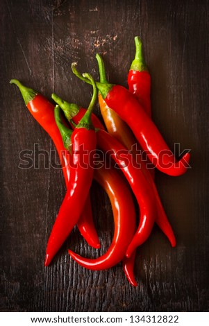 Red chili on an old wooden background.
