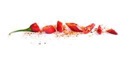 Red chili pepper, cut into pieces and isolated on white background. Hot spice, red chili pepper and chili powder.