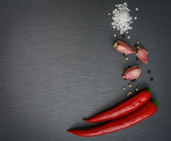 Red chili pepper on slate plate. Chilli pepper, dry pepper, papr