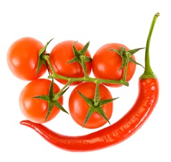 Red chili pepper with tomatoes isolated on white