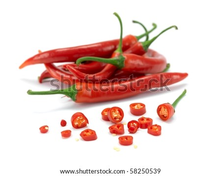 Red chili peppers isolated against a white background