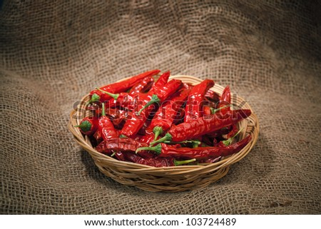 red chili peppers on the wicker dish, sacking background