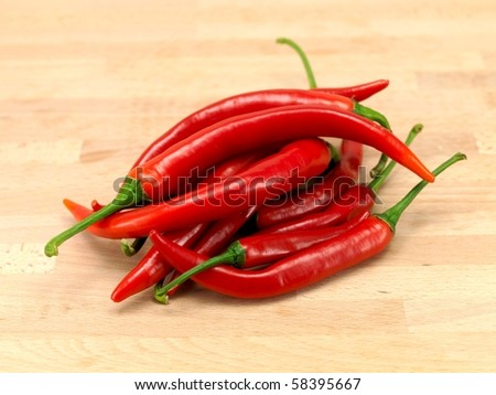 Red chilli peppers on a wooden bench