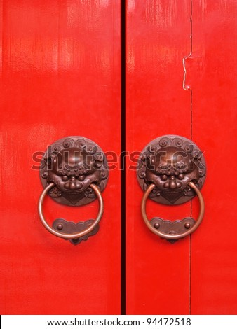 Red chinese door with a lion/dragon head. - stock photo