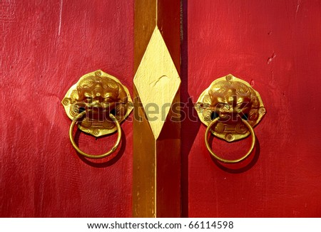 Red chinese door with a lion-singha head. Chinese New Year celebration at Thailand