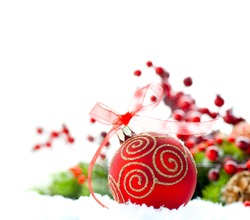 Red Christmas and New Year Decoration isolated on white background. Border art design with holiday bauble. Beautiful Christmas tree closeup decorated with ball, holly berry. Space for your text.