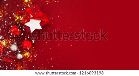 Red Christmas background with xmas gifts. Merry Сhristmas greeting card. Winter season holiday background. Happy New Year. #1216093198