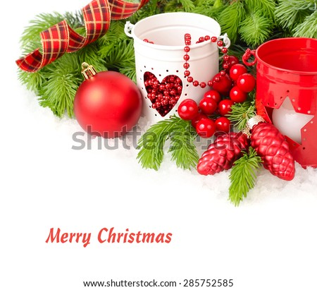 Red Christmas ball both red and white candlesticks on a white background. A Christmas background with a place for the text.