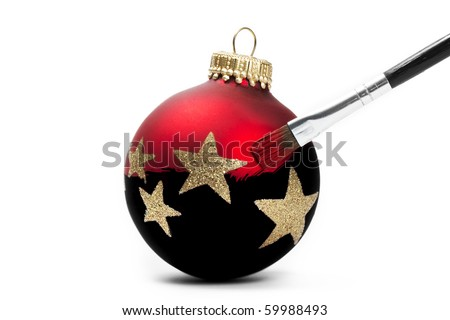 red christmas ball gets his color with a brush on white background
