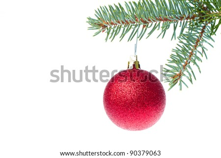 red christmas ball hanging from tree isolated on white background