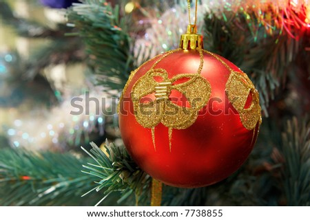 red Christmas ball hanging on branch