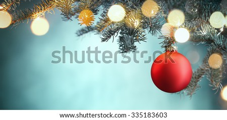 Red Christmas ball hanging on Christmas tree. stock photo