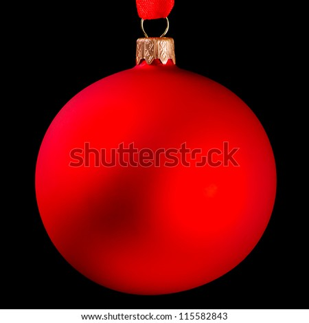 Red Christmas ball isolated on black background