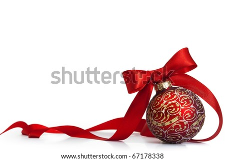 Red Christmas ball on a glossy surface