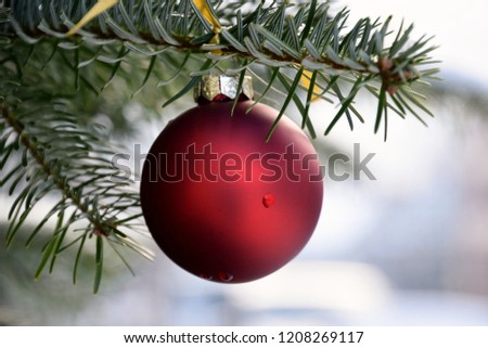 Red Christmas ball on Christmastree