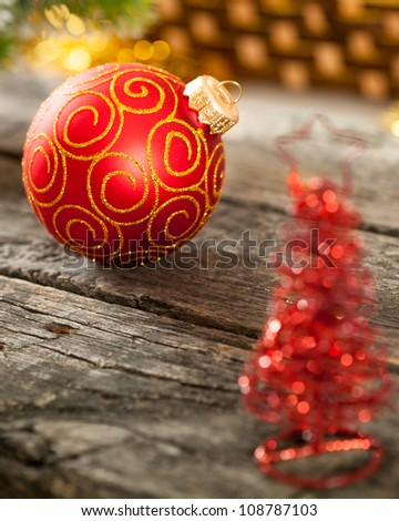 Red Christmas ball on wooden table