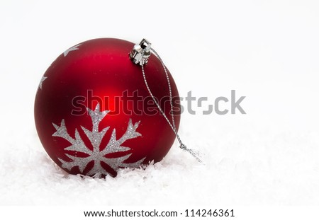Red Christmas ball ornament with silver stars on white