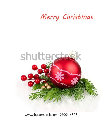 Red Christmas ball with a pattern and red berries on branches of a Christmas tree. A Christmas background with a place for the text.