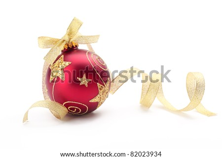 Red christmas ball with gold ribbon bow on white background. - stock photo