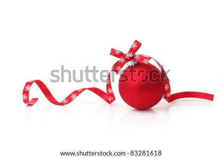 Red christmas ball with ribbon bow on white background.