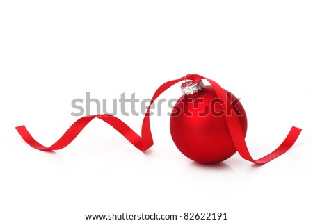 Red christmas ball with ribbon on white background.